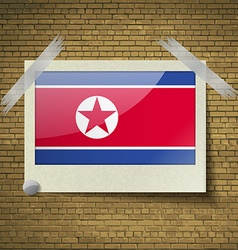Flags korea north at frame on a brick background vector