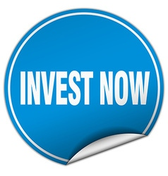 Invest now round blue sticker isolated on white vector