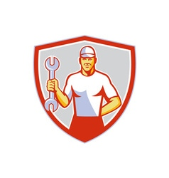 Mechanic holding wrench crest retro vector