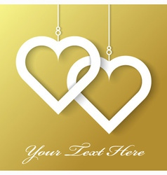 Two hearts applique on gold background vector