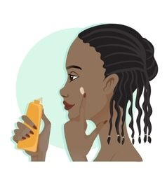 African american girl applies a cream on the skin vector