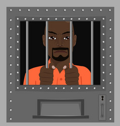 African american man looking from behind bars vector