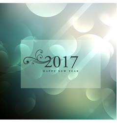 Beautiful bokeh background with 2017 text in vector