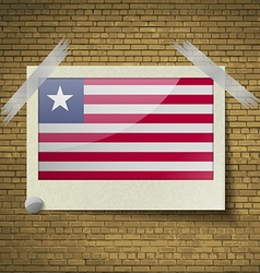 Flags liberia at frame on a brick background vector