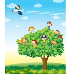 Kids playing on tree vector