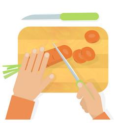 Hands cutting carrot vector