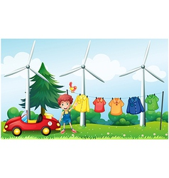 A boy in the garden with his car and hanging vector image