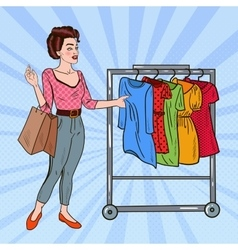 Pop art woman with shopping bags choosing dress vector