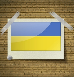 Flags ukraineat frame on a brick background vector