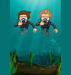 two men scuba diving under the ocean vector image