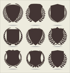 Shield and laurel wreath vector
