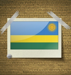 Flags rwandaat frame on a brick background vector