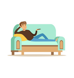 Young man lying on a sofa and watching tv male vector