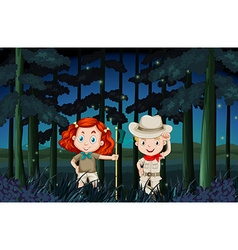 Boy and girl camping out at night vector