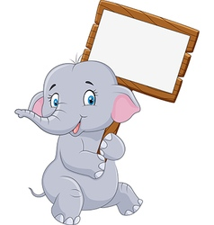 Cartoon funny elephant holding blank sign vector image