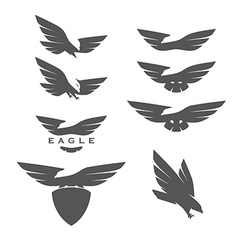 Set of negative space emblems with eagles vector