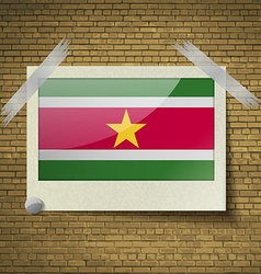 Flags suridameat frame on a brick background vector