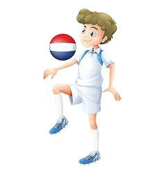 A player using the ball with the flag of vector image