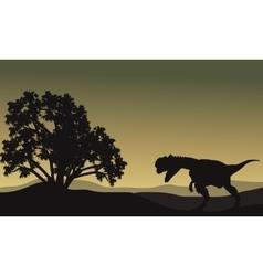 Dilophosaurus in hills scenery silhouette vector image