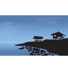 Morning with hut and rocks at the beach vector