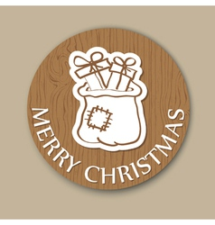 Round wood christmas card with santa bag vector