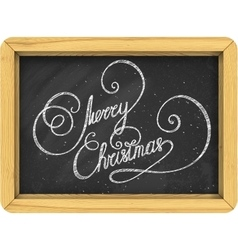 Merry christmas lettering on blackboard vector