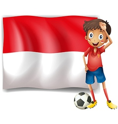 A boy with a soccer ball standing in front of the vector