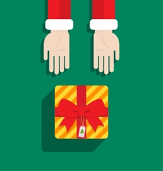 Santa claus hand give gift merry christmas vector