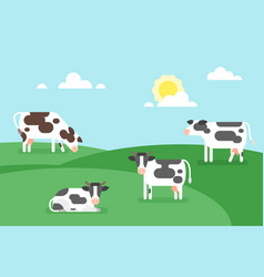 Cows graze in a field vector