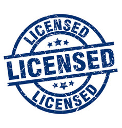 Licensed blue round grunge stamp vector