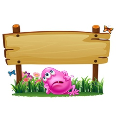 A tired monster under the empty signboard vector image vector image