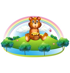 A bear holding a pot of honey at the hill vector image