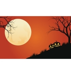 Silhouette of pumpkins in hills halloween vector