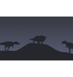 Silhouette of mapusaurus and triceratops dinosaur vector