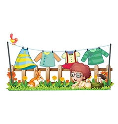 A boy and a bunny in a garden with hanging clothes vector image