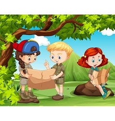 Three kids reading maps in the field vector