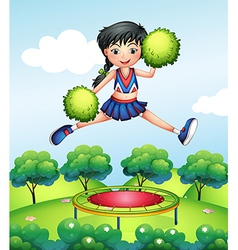 A cheerleader jumping with her green pompoms above vector image vector image