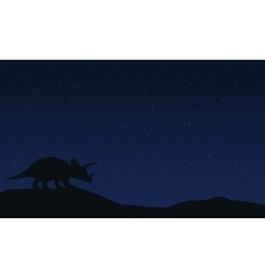 Silhouette of triceratops at night landscape vector image vector image