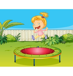 A girl jumping on a trampoline vector image