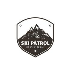 Vintage hand drawn mountain ski patrol emblem vector