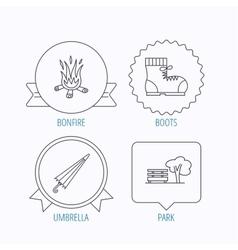 Bonfire umbrella and hiking boots icons vector image