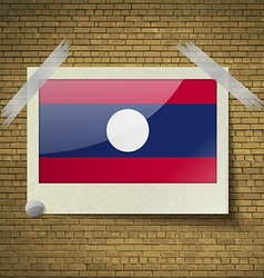 Flags laos at frame on a brick background vector