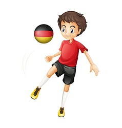 A boy using the soccer ball with the flag of vector