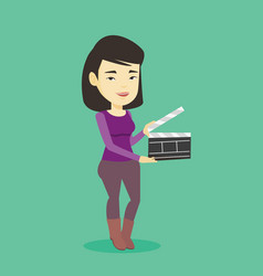 smiling woman holding an open clapperboard vector image