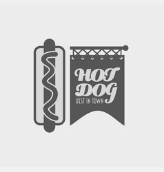 Hot dog in a badge label or logo concept poster vector