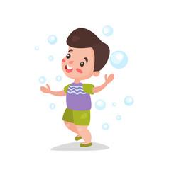 cute cartoon brunette little boy having fun vector image vector image
