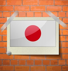 Flags japan scotch taped to a red brick wall vector