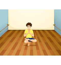 A man performing yoga inside a room vector image vector image