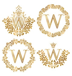 Golden w letter vintage monograms set heraldic vector