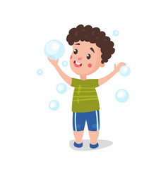 cute cartoon little boy having fun playing with vector image vector image